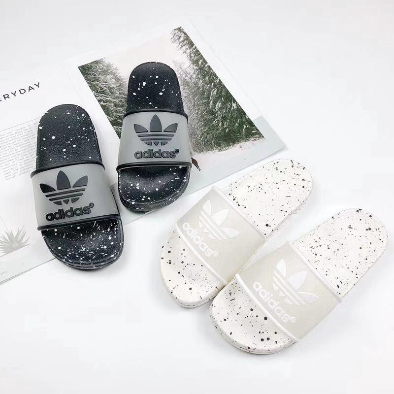 chinelos nike e adidas